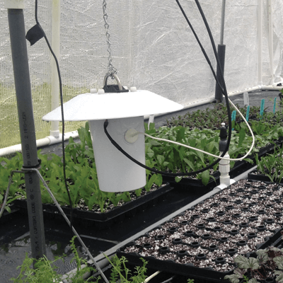 Apogee TS-100 aspirated radiation shield in a greenhouse.